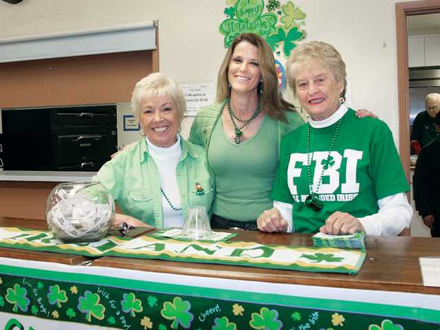 Left to right, Roberta Como, Candy Johnson and Evie Leslie worked the bar for the corned beef and cabbage feed.