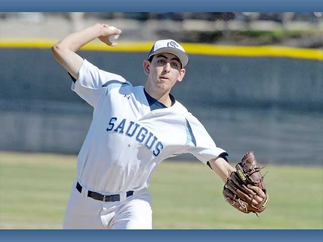 Saugus pitcher Justin Donatella delivers a pitch against Canyon High on Wendesday at Saugus High School. The Centurions defeated Canyon 3-1.