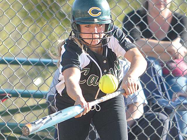 Canyon's Tiffany Dyson lays down a sacrifice bunt in the second inning against Knight High at Canyon on Wednesday.