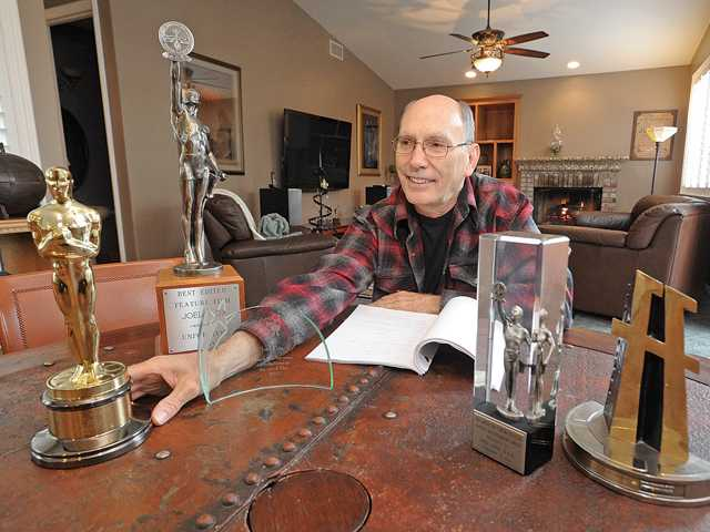Academy Award-winning film editor Joel Cox with his Oscar, left, and his many awards for film editing.