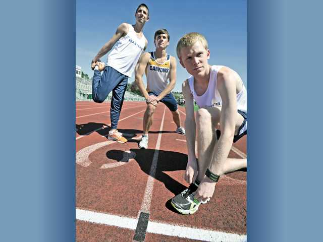 The Master's College's Anthony Pizzo, left, and John Gilbertson, right, have already qualified for NAIA nationals in three different events, while College of the Canyons' Chris Low, center, is chasing a UCLA scholarship in the 800.