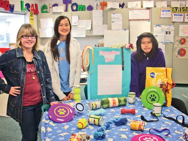 Sixth-graders Nicole Hoppes, Kiana Quick and Alina Truong are part of a student effort at Newhall School District to help local animals in shelters. The students organized a donation drive to collect care items for animals. For the story, see SCV Schools, A5.