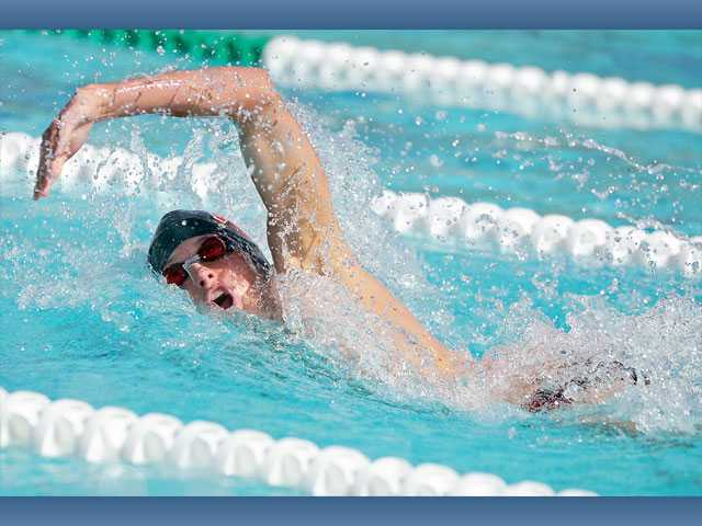 Hart's Matt Johnson competes in the 200-yard freestyle on Tuesday at the Santa Clarita Aquatics Center. The Indians won both the boys' meet and the girls' meet.