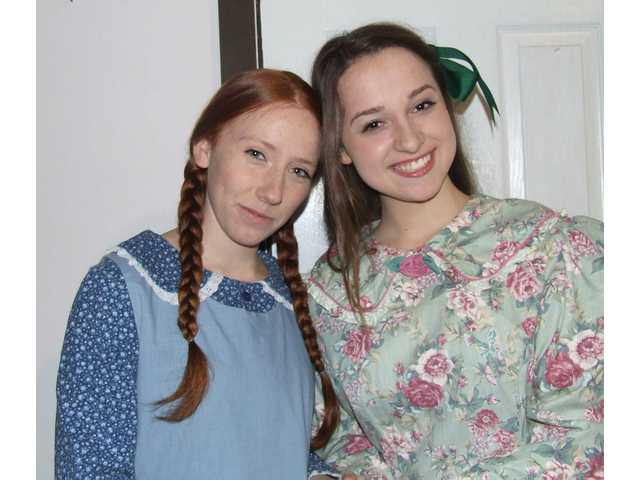"Sandra Kate Burck as Anne, and Tyler Joy Bannerman as Diana in ""Anne of Green Gables."""