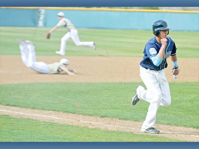 Saugus High's Andru Cardenas pumps his fist on his run towards home as West Ranch third baseman Justin Hovis, middle, and second baseman J.D. Krauskopf miss a line drive in the third inning on Wednesday at West Ranch High.