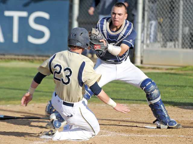 Saugus catcher Nick Warren makes a tag on West Ranch's Josh Heinz in the seventh inning on Wednesday at West Ranch High. Saugus won 6-4 over the Wildcats.