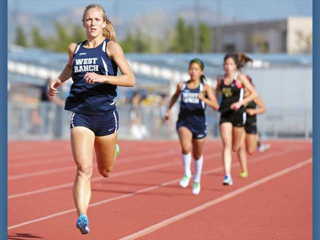 West Ranch's Ashley Welker gets ahead of the pack during the 800 on Thursday at Golden Valley High School. Welker ran a season-best time of 2:17.78 to win the event.