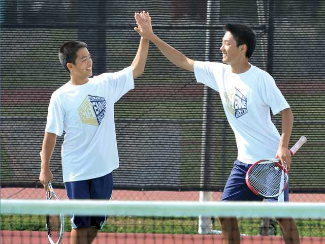West Ranch's doubles team of Chris Gaw, left, and Jonathan Lee celebrates a win on Thursday at Hart High School.