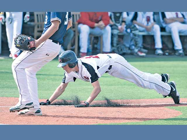 Santa Clarita Christian's Clint Ross, right, slides into home on a wild pitch on Friday at The Master's College.