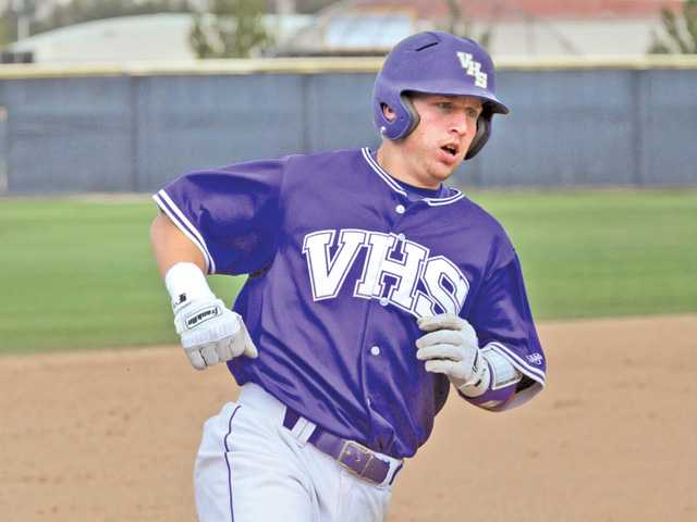 Valencia catcher Brian Mundell rounds third base after hitting a home run on Saturday at Valencia High.