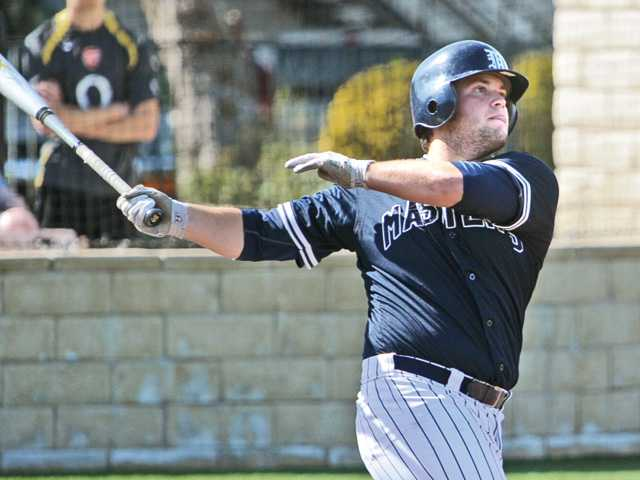 The Master's College's Joe Riddle belts a home run against La Sierra University at Reese Field on Tuesday.
