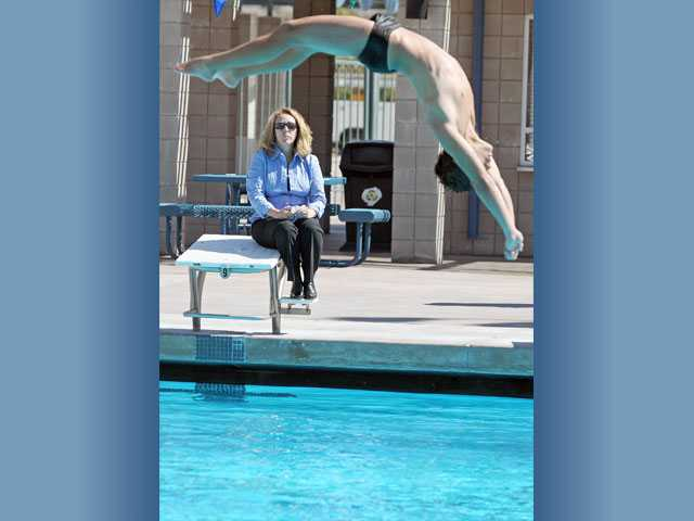 William S. Hart Union High School District diving coach Kerry Frick, left, watches one of her divers practice at the Santa Clarita Aquatic Center on Monday.