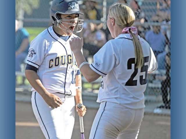 College of the Canyons players Ruby Herrera, left, and Amy Droege celebrate against Glendale College on Tuesday at College of the Canyons.