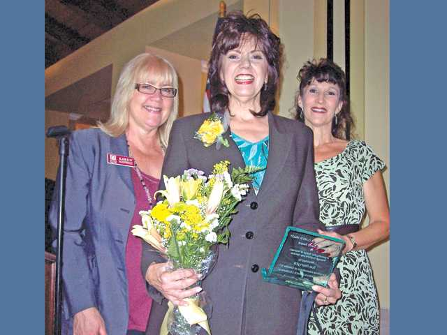 Christine Sexton, daughter of Carmen Sarro, right, presented the Carmen Sarro Community Service Award to Sue Reynolds, of Soroptimist International of Greater SCV. At left is Karen Maleck Whiteley, Zonta chairwoman of the Women in Service Celebration brunch.