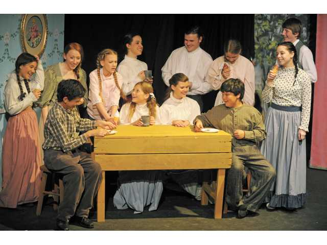 "School children have fun in a scene from ""Anne of Green Gables,"" which is now playing at the Canyon Theatre Guild in Newhall."