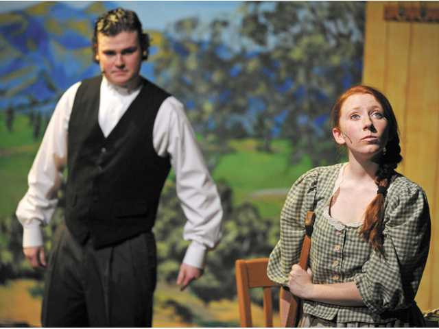 Marcus Langston (Gilbert Blythe) and Sandra Kate Burck (Anne Shirley) pretend they don't like each other. This musical version of the classic novel runs on Saturdays and Sundays at 2 p.m. through April 29, with a 6 p.m. performance on Sunday, April 22.