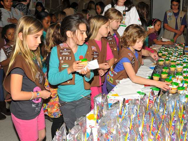 A party for 126 Girl Scouts was recently held in honor of the 100th birthday of Girl Scouts of America. The Girl Scouts each decorated bags and brought a donation of cake mix and frosting for a Birthday-in-a-Bag. The bags were donated to Help the Children.