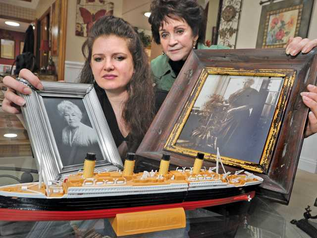Lisa McDougald, left, and her aunt, Linda McDougald Watson, display photos of Mary McDougald Fortune, who survived the Titanic when it sank in the early morning hours of April 15, 1912.