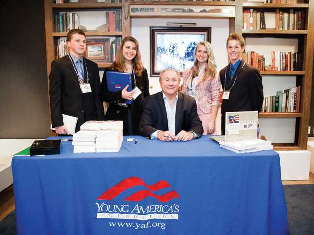 Students from Trinity Classical Academy pose with Michael Reagan, center, as part of the recent Young America's Foundation Conference at the Reagan Ranch in Santa Barbara.