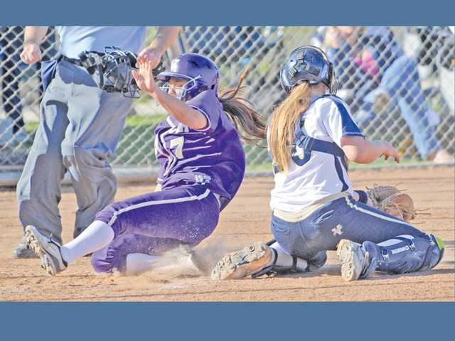 Valencia's Chelsea Dolan (7) slides across home plate as West Ranch catcher Janelle Lindvall drops the throw during the sixth inning on Tuesday at West Ranch High.