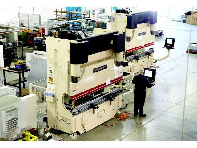 An operator programs one of two CNC press brakes recently installed at Bayless Engineering and Manufacturing as part of a $2 million investment in equipment that also included a 4,000-watt fiber optic laser cutter and a robotic welder.
