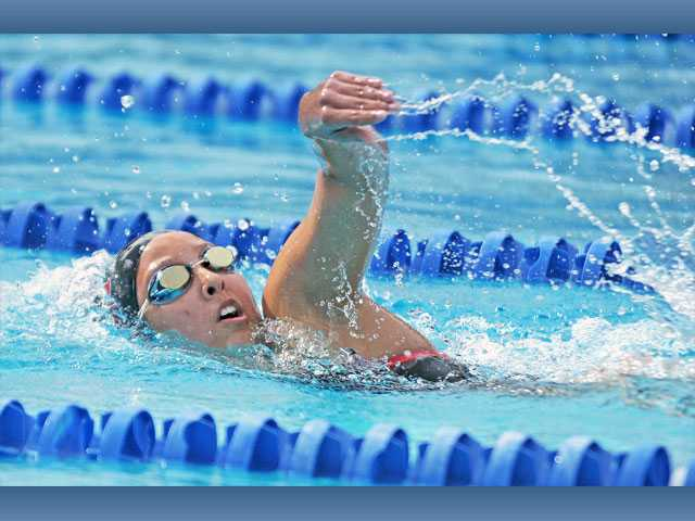 Hart High swimmer Christine Lusk competes in the 500-yard freestyle against Golden Valley on Wednesday at the Santa Clarita Aquatic Center. Lusk won the event and the Indians went on to defeat the Grizzlies on the girls' and boys' sides.