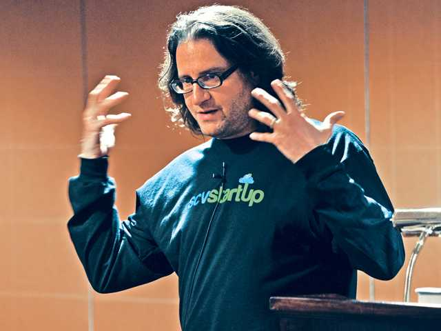 Guest speaker venture capitalist Brad Feld addresses a group local high-tech startup entrepreneurs at the SCV Startup meeting held at the Embassy Suites Hotel in Valencia on Wednesday.