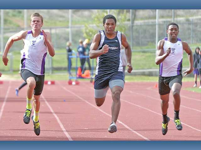 Saugus' Quentin Hendrix, center, competes in the 100-meter dash in a meet against Valencia on Thursday at Saugus High School. The boys tied 68-68 and the Saugus girls won 80-56.
