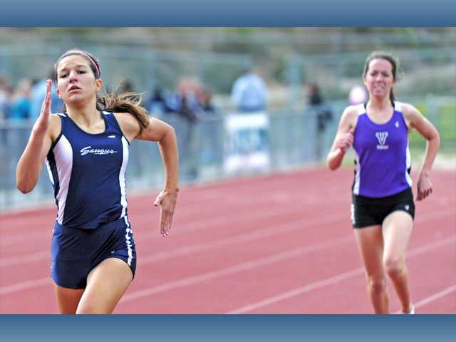 Saugus' Sabrina Janes pulls away from Valencia's Olivia Pear to win the 800-meter race on Thursday at Saugus High School.