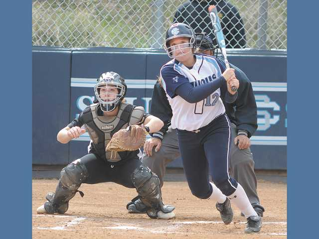 Saugus' Alyssa Rodriguez, right, and Canyon catcher Courtney Ziese watch Rodriguez' double in the second at Saugus High on Thursday. Saugus won 13-3.