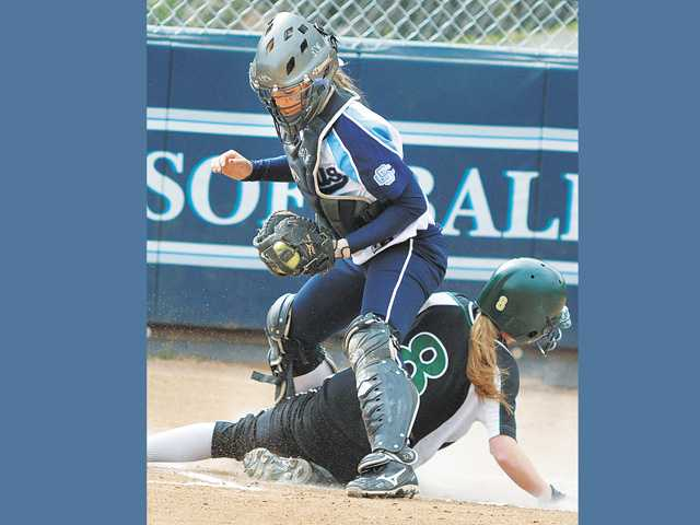 Saugus catcher Karlee Bickford straddles Canyon base runner Kaelie Doyle (8) after making the tag at home plate in the first inning at Saugus High on Tuesday.