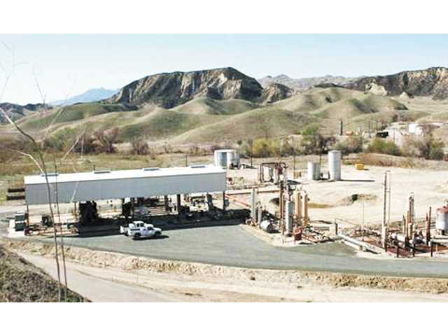 Newhall Land leases land with active oil wells, like the one pictured on the right, to oil and gas companies. The leases generate income and, in part, help sustain the company while it waits to turn its first shovelful of dirt on the Newhall Ranch project.
