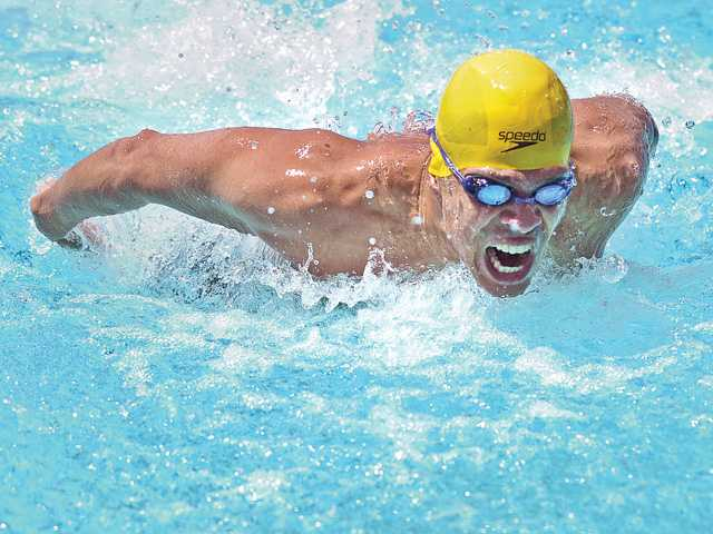 Mario Marshall, a Santa Clarita Masters Club team member and Olympic hopeful, wins the 100-yard butterfly at the Southern Pacific Master Swimming Regional Championship meet on Saturday at the Santa Clarita Aquatic Center.