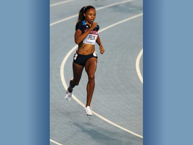 Allyson Felix competes in a first-round heat of the Women's 400-meter race at the World Athletics Championships in Daegu, South Korea on Aug. 27, 2011.
