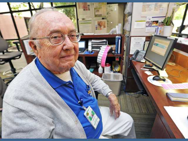 Robert Hill staffs the information desk at Henry Mayo Newhall Memorial Hospital. Hill has volunteered at the hospital for more than 12 years.