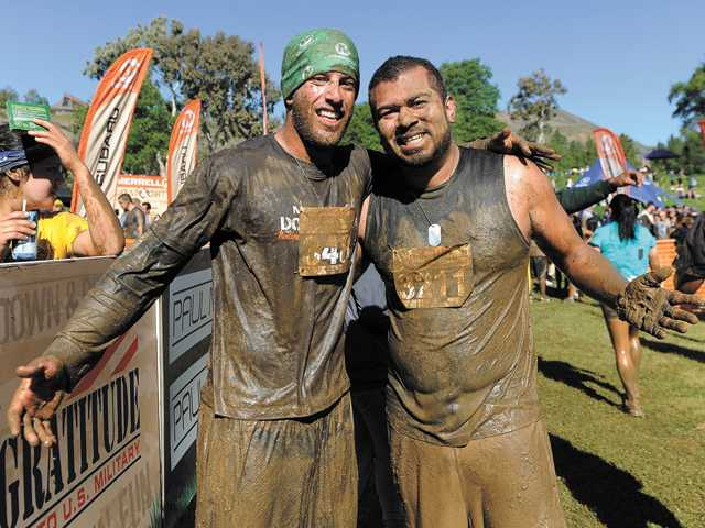 Michael Morgan and William Flores, of Santa Clarita, pose for a photo after finishing the race at Castaic Lake on Sunday.
