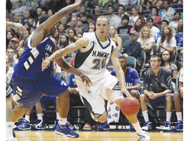 Golden Valley High graduate Trevor Wiseman (20) is leaving the University of Hawaii's men's basketball program.
