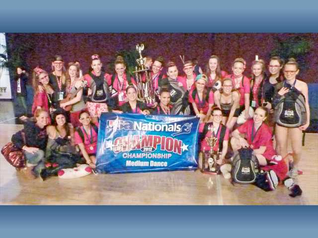 Hart High School's dance team shows off its national win at the recent USA National Dance competition in Anaheim.