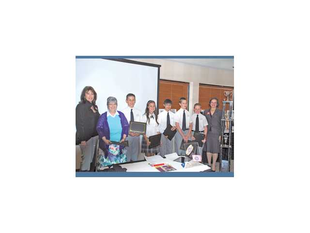 This year's winners were a seventh-grade team from Our Lady of Perpetual Help School in Newhall. They worked on a marketing campaign for Jersey Mike's. From left to right, VIA STAR chairwoman Laura Kirchhoff, teacher coach Anne Marie Rudzinski, Michael Salerno, Samantha Dickson, Paola Arguelles, Charlie Brady and Joey Garlarneau.