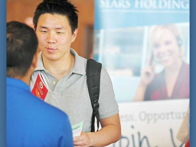 Ray Choi, of Saugus, speaks to a job recruiter.