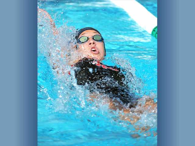 Hart's Megan Schultz swims the 100-yard backstroke on Wednesday at the Santa Clarita Aquatic Center.