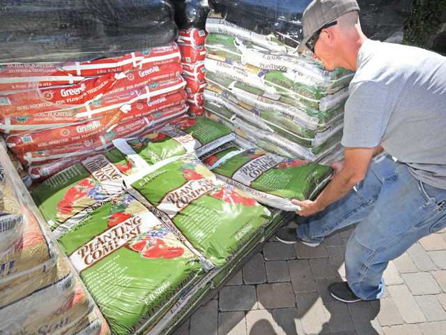 James Green with E.B. Stone Organic Planting Compost ($5.99 for 1.5 cubic feet).