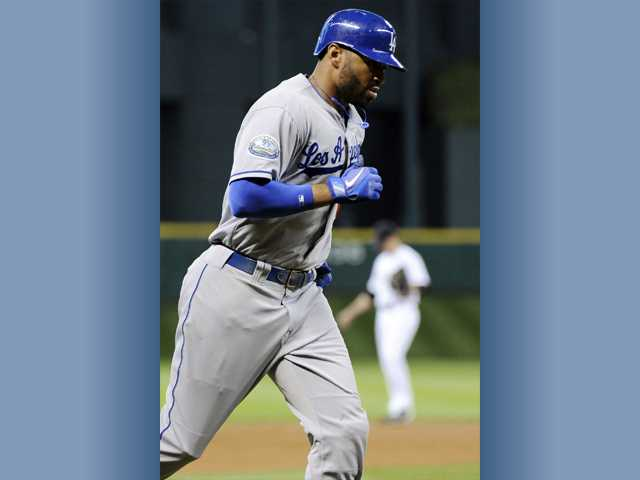 Los Angeles Dodgers' Matt Kemp rounds the bases on a two-run home run against the Houston Astros in the first inning of a baseball game Friday in Houston.