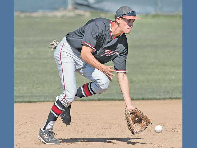 Hart shortstop Luke Persico scoops up a ground ball in the third inning against Canyon during Friday's game at Canyon High School. Hart won the game 10-2.