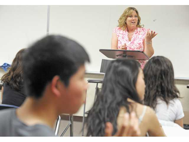 Valencia High counselor Kathy Stroh speaks with Joe Rosenast's Advanced Placement English class Wednesday.