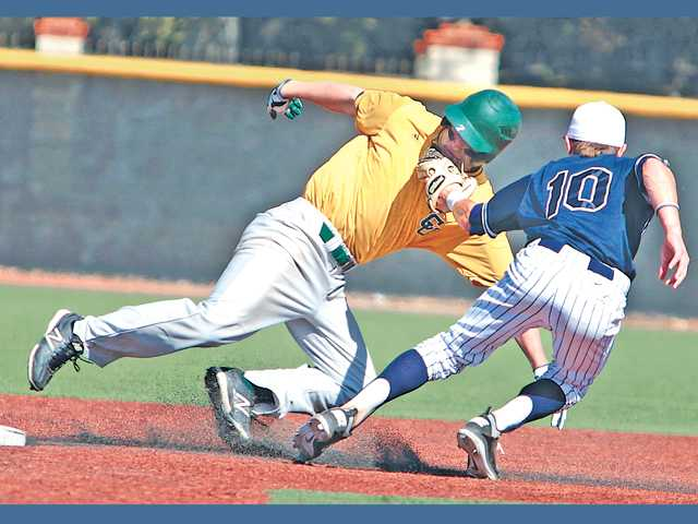 The Master's College second baseman Sam Robison tags out Concodia University's Aaron Gates as he tries to steal second base on Saturday at Reese Field.