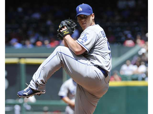 Dodgers starting pitcher Chad Billingsley winds up as he faces the Astros on Sunday in Houston.