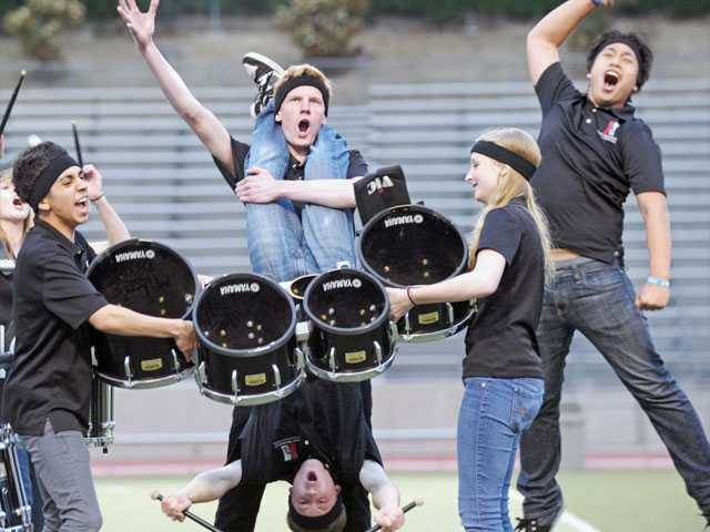 Hart High drumline members, clockwise from top center, Sam Lowen, Allison Degenfelder, Allen Lorenzana, Mike Hill and Anthony Garcia cheer during a routine. The program won $1,000 from Nissan of Valencia by winning a drumline competition.
