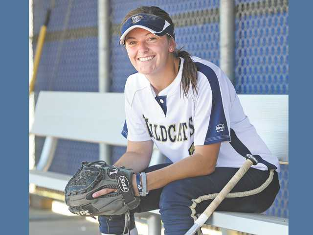 West Ranch junior shortstop Kylie Sorenson looks after her twin sisters while her parents are working.