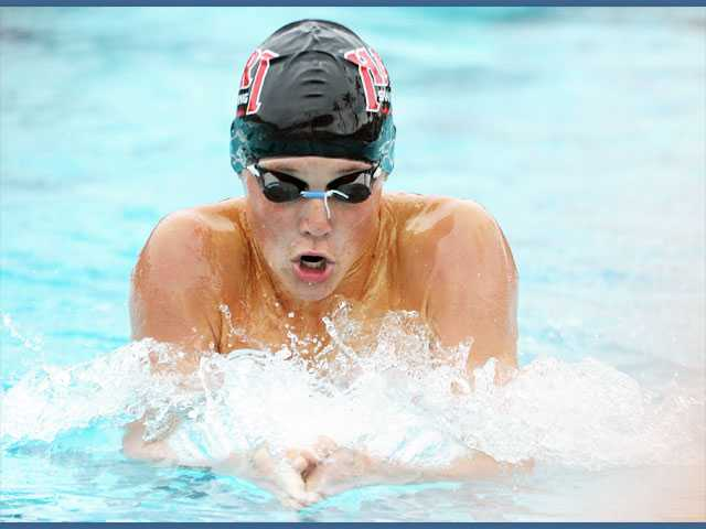 Hart High's Cole Cogswell swims in the 200-yard individual medley against Valencia at the Santa Clarita Aquatic Center.